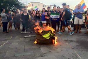 Demonstrators Burn Ruling Party T Shirts On San Cristóbal Island.